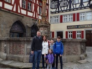 5 of us in the town square (A is the photographer)